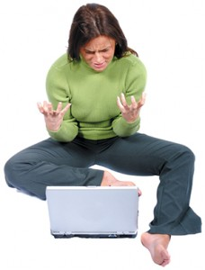 Frustrated lady looking at laptop